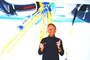 Ture Sjolander in front of a large painting on canvas, 2001.